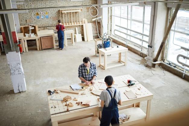 Three carpenters working background