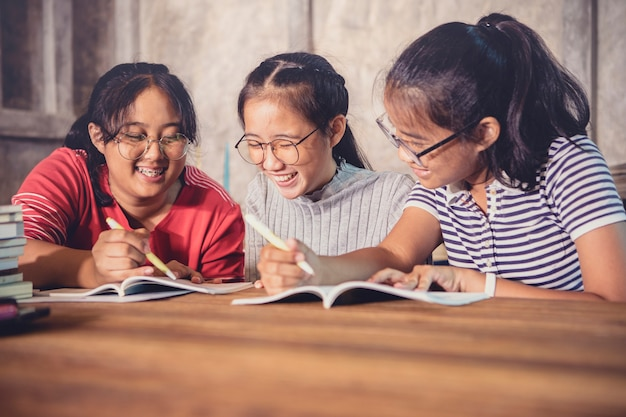Three of cheerful asian teenager tutorial for school homework happiness emotion