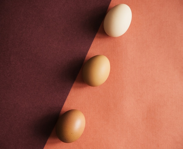 Three chicken eggs are laid on paper of natural colors. the texture of the paper and the egg is beige.easter eggs.