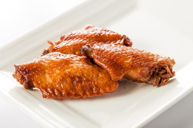 Three chicken wings
