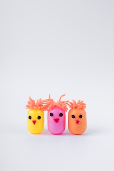 Three chickens made of egg toy boxes on table