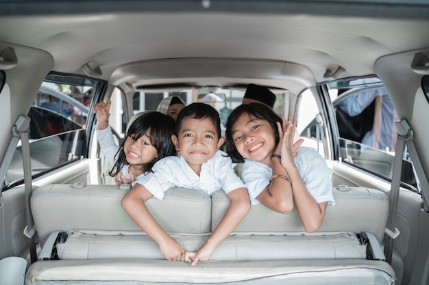 Three children excited to go on holiday