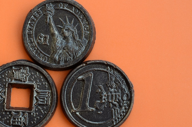 Three chocolate products in the form of euro, usa and japan