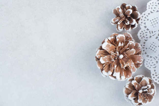 Three christmas pinecones on white background. high quality photo