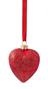 Three christmas red balls hanging from ribbon on white
