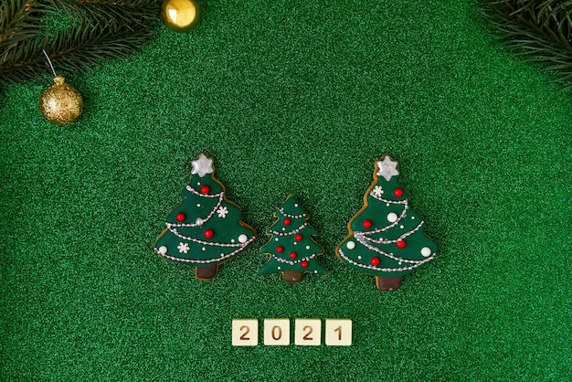 Three christmas trees gingerbread written the letters of the numbers 2021
