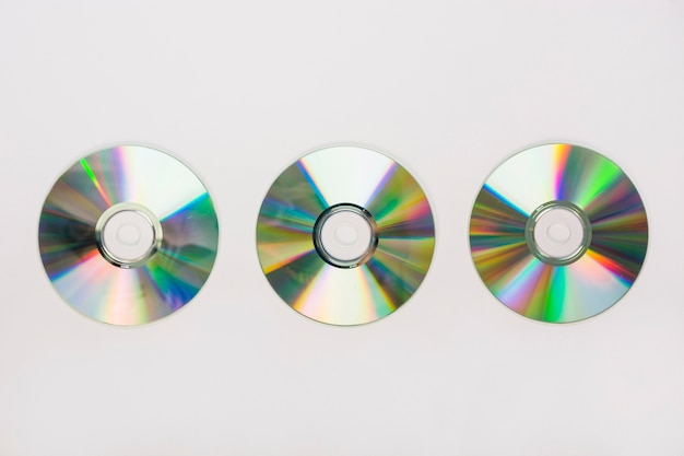 Three circular compact disc on white background
