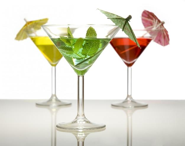 Three cocktails with umbrellas