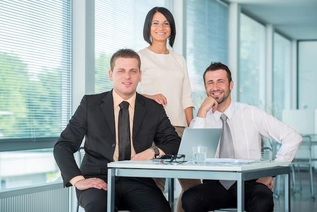 Three coleagues posing