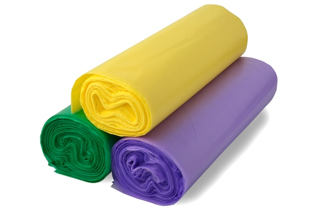 Three coloful rolls of polythene bags.