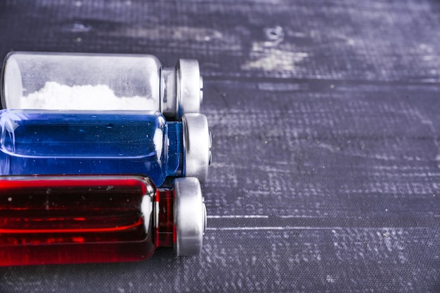 Three color white and red and blue medicine vial or ampoules