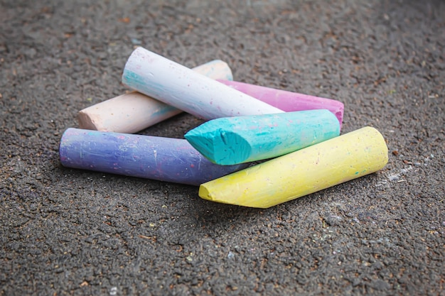 Three colored stripes, drawing with chalk on asphalt. selective focus.arts