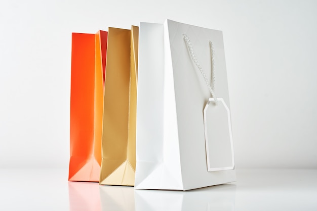Three colorful paper shopping bag on a white