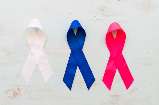 Three colorful ribbons on grunge background