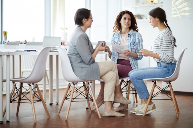 Three contemporary women at work