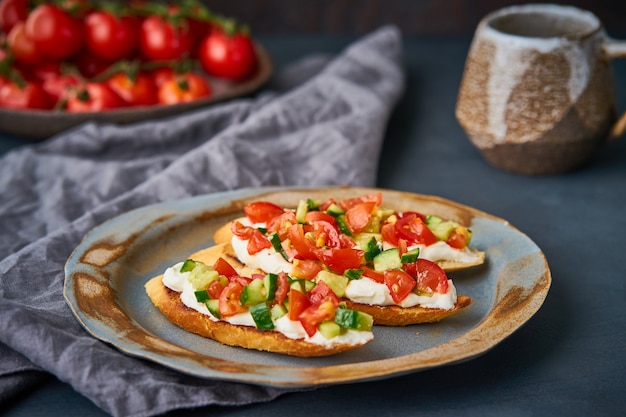 Three crostini, traditional italian sandwich with tomatoes and cucumbers