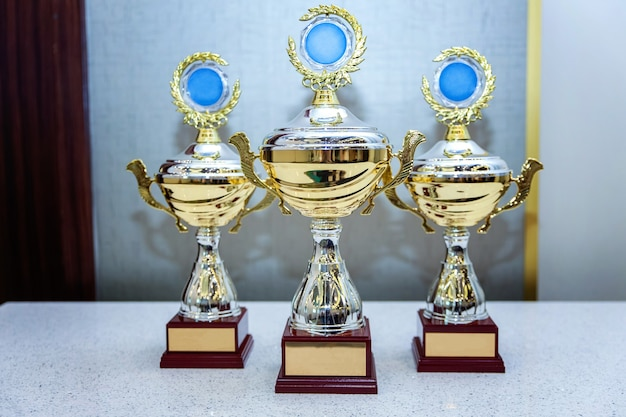 Three cup trophies, gold, silver and bronze