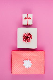 Three different gift boxes on table
