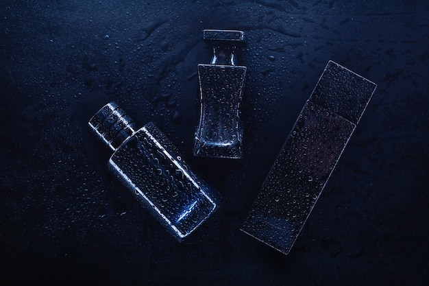 Three different perfumes on a dark background