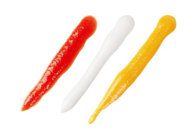 Три разных соуса на белом фоне
