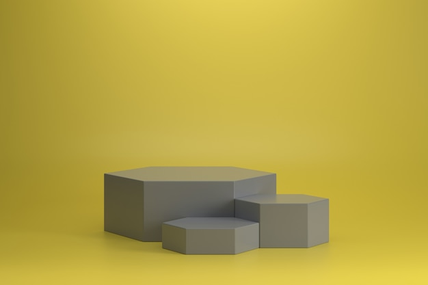 Три разных размера окончательного серого шестиугольного подиума на освещенном желтом фоне.