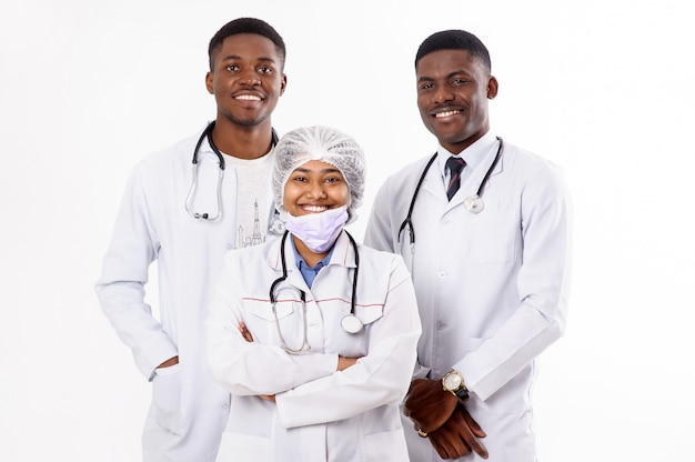 Three doctors on a white. indian woman with a stethoscope. african men.