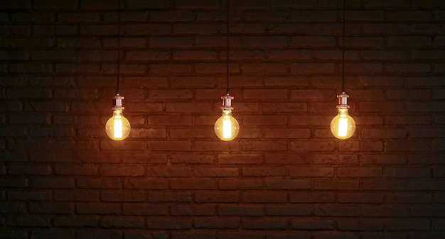 Three edison lamps against a structured brick wall