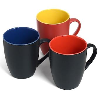 Three empty ceramic mugs on white