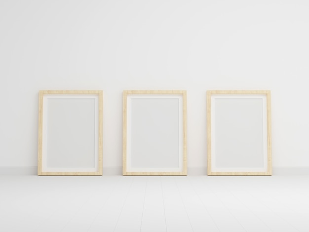 Three empty photo frame for mockup in empty white room