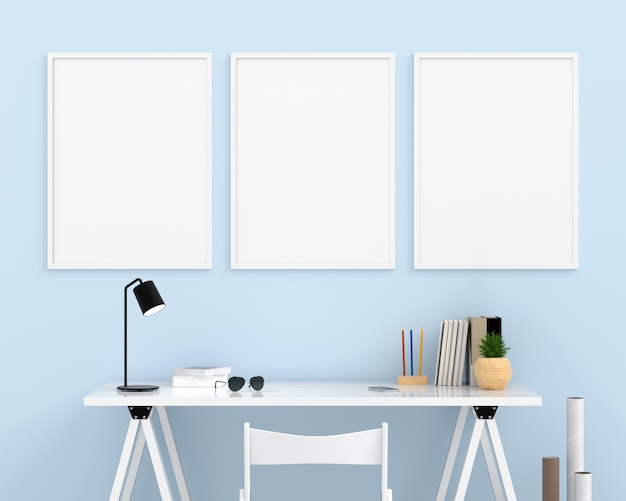 Three empty photo frame for mockup on light blue wall