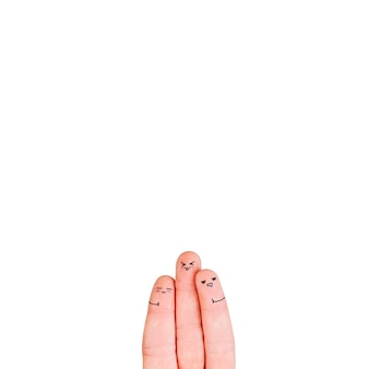 Three fingers with faces on white