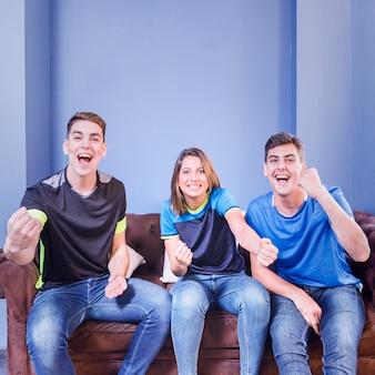 Three football fans celebrating