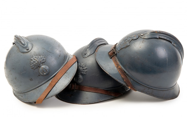 Three french military helmets of the first world war on white