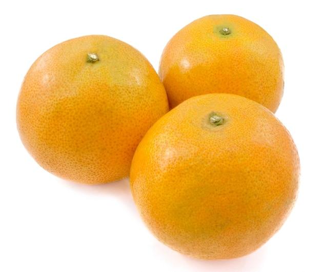 Three fresh oranges on white