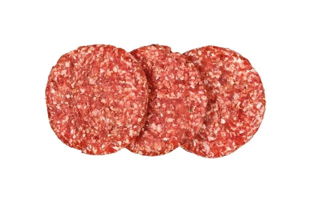白い背景、高架上面図、真上に分離されたハンバーガー用の3つの新鮮な生の牛肉肉バーガー