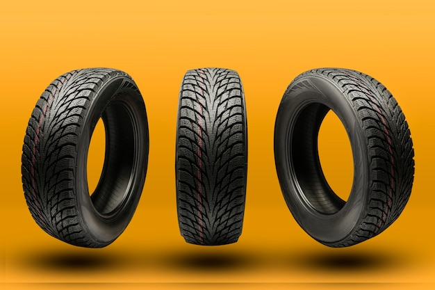Three friction tires, winter season re-booting, on a bright orange background.
