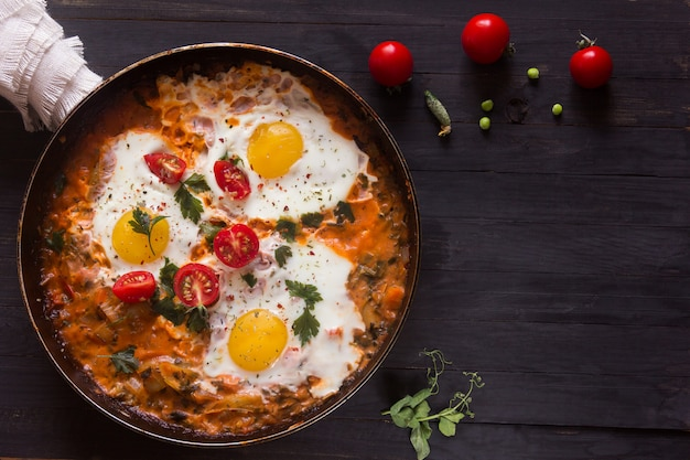 Three fried eggs with ã'âherry tomatoes