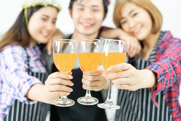 Three friends enjoying party glass, drinking orange juice cocktail together