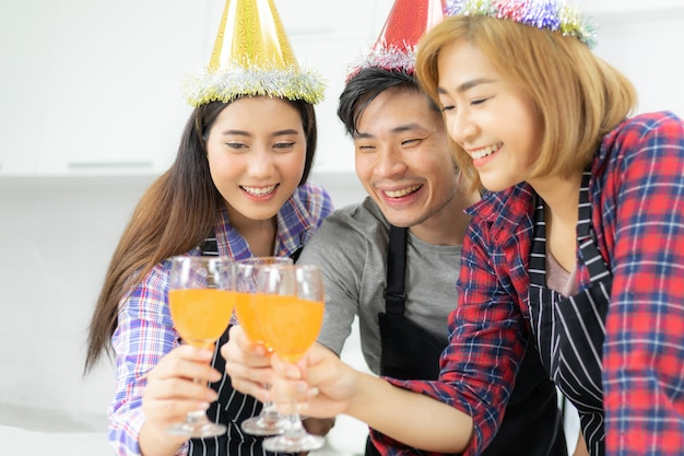 Three friends enjoying party glass , drinking orange juice cocktail together