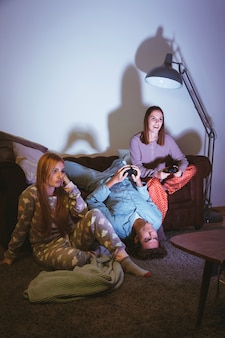 Three friends playing on the console