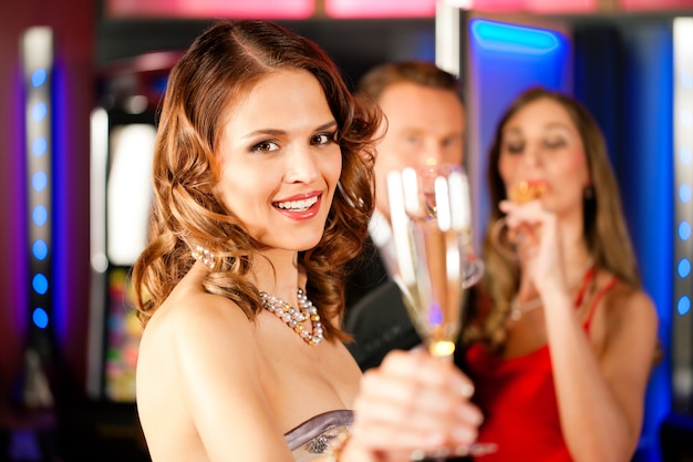 Three friends with champagne in a bar