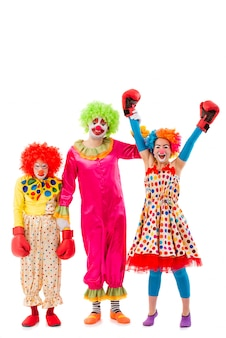 Three funny playful clowns isolated