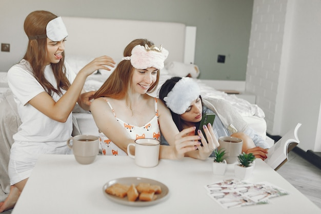 Three girls have pajamas party at home
