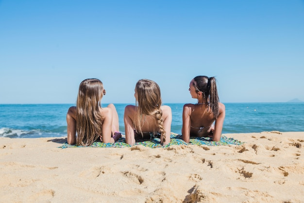 Three girls taking a sunbath