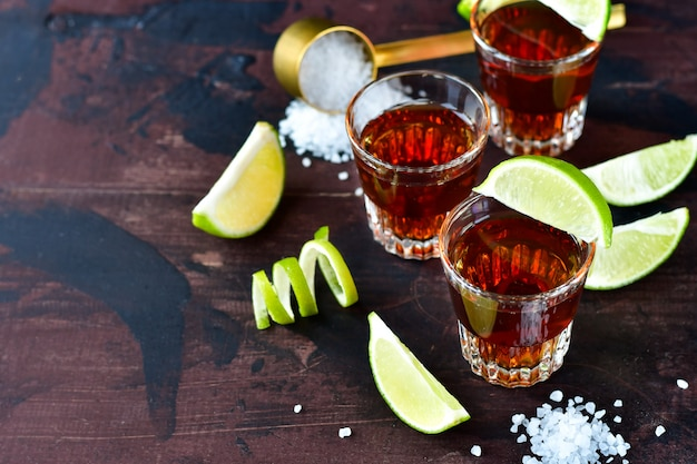 Three glasses of alcohol and lime and salt, a party at the bar, a menu for the bar