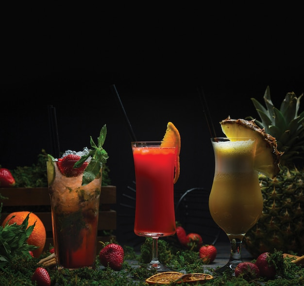 Three glasses of tropical fruit cocktails