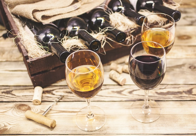 Three glasses of wine on a wooden table. wine of a new harvest