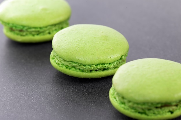Three green macaroons in kitchen