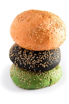 Three, hamburgers on colorful bred buns in red , green and black