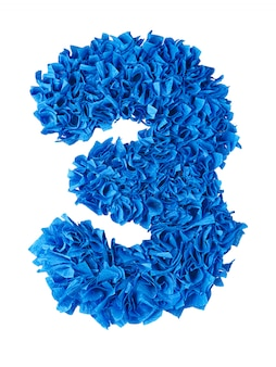 Three, handmade number 3 from blue scraps of paper isolated on white